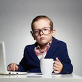 stock image of  Young business boy. child in glasses. little boss in office