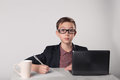 Young business boy in suit and glasses Royalty Free Stock Photo
