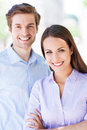 Young business couple standing outdoors Royalty Free Stock Image