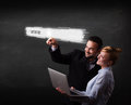 Young business couple touching web browser address bar with www sign Royalty Free Stock Photos