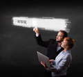 Young business couple touching web browser address bar with www sign Royalty Free Stock Photography