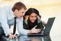 Young business couple using laptop outdoor happy Royalty Free Stock Images