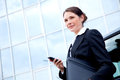 Young business lady outside with mobile phone Royalty Free Stock Photo
