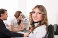 Young business lady smiles in office Royalty Free Stock Photo