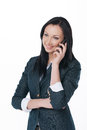 Young business lady talking by phone and smile standing on white isolated background Royalty Free Stock Photo