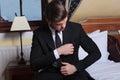 Young business man adjusts pocket napkin Royalty Free Stock Photo
