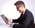 Young business man browsing on his tablet pad Stock Images
