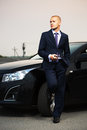 Young business man with a cell phone at the car Royalty Free Stock Photo