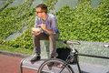Young business man eating at lunch break outdoors Royalty Free Stock Photo