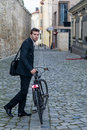 Young business man with his bicycle ona pedestrian area of the city Royalty Free Stock Photos