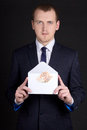Young business man holding envelope with money euro banknotes Stock Images
