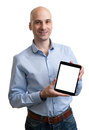 Young business man holding his tablet portrait of a Royalty Free Stock Images