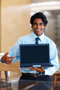 Young business man holding laptop Royalty Free Stock Photography
