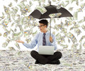 Young business man holding a umbrella with dollar rain background Royalty Free Stock Photo