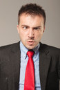 Young business man making a angry face Royalty Free Stock Photo