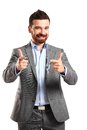 Young business man pointing to the camera on white background Stock Photography