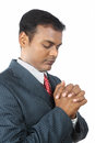 Young Business Man Praying Stock Image