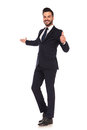 Young business man presenting and making the ok hand sign Royalty Free Stock Photo