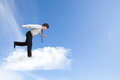 Young business man running on cloud over sky business concept Royalty Free Stock Images