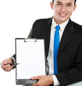 Young business man showing blank clipboard Royalty Free Stock Photography
