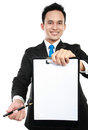 Young business man showing blank clipboard Stock Image