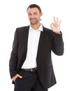 Young business man showing ok sign smart indicating isolated over white background Stock Photo