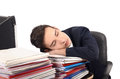 Young business man sleeping on a stack of paper work tiered employee the job Royalty Free Stock Photography