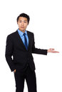 Young business man smile introduce with hand gesture isolated on white background Royalty Free Stock Photography