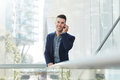 Young business man smiling with mobile phone Royalty Free Stock Photo