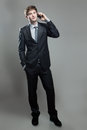 Young business man talking on cell phone Royalty Free Stock Photo