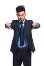 Young business man with thumbs down hand gesture Royalty Free Stock Photo