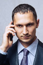 Young business man using cell phone Royalty Free Stock Image