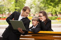 Young business man and woman using laptop in park people a city Stock Photography