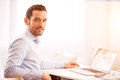Young business man working at home on his laptop Royalty Free Stock Photo