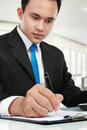 Young business man writing Royalty Free Stock Photo