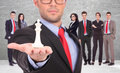 Young business men leader of a successful business team holding the white king of chess on the top of his hand Stock Photography