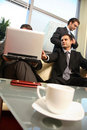 Young business men in office environment Royalty Free Stock Photo