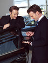 Young business men out side of office working in car Royalty Free Stock Images