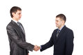Young business men shaking hands Stock Photos
