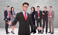 Young business men welcoming you to his successful team on gray background Stock Images