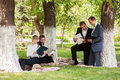 Young business men and women in a city park Royalty Free Stock Photo