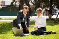 Young business people using laptop in a city park men and women Stock Photography