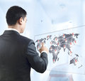 Young business person pointing on the map with view from back side world Royalty Free Stock Photos