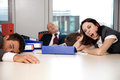 Young business team exchausted and over worked Stock Image