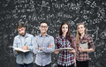 Young business team and formulas, blackboard Royalty Free Stock Photo