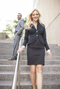 Young business team on stairs woman in front Royalty Free Stock Photo