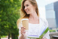 Young business woman with coffee to go and green notebook Stock Photography