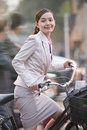 Young business woman commuting with a bicycle beijing china Royalty Free Stock Images