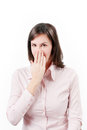 Young business woman covering with hand her mouth.