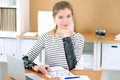 Young business woman designer working on laptop in office. Successful startup business concept. Royalty Free Stock Photo